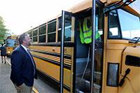 bus driver and superintendent talking on the first day of school