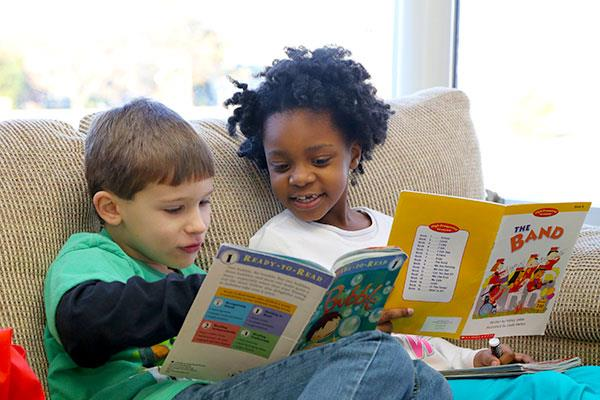 Kindergarten students reading books